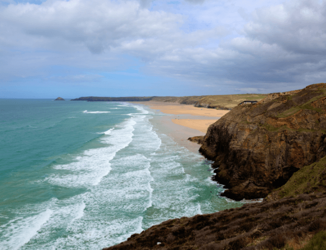 The South West Coastal Path looking towards Perranporth and Perran Sands.